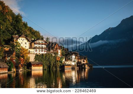 Scenic View Of Famous Hallstatt Lakeside Town Reflecting In Hallstattersee Lake In The Austrian Alps