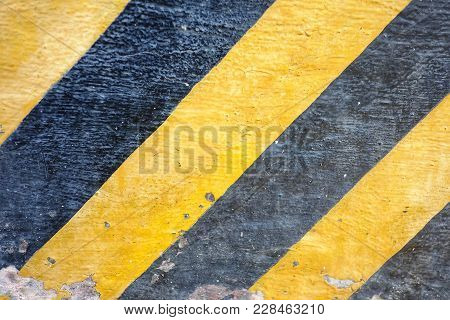 Close Up Yellow Black Line Of A Caution Sign On The Rough Cement Box For Background Texture