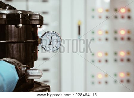 Selective Focus At Valve And Gate Measurement Of Big Water Pump / Background With Light Of Electric