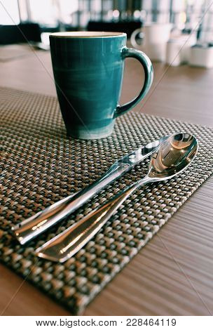 Selective Focus At Spoon , Knife And Cup Of Coffee On The Breakfast Table. / Concept Of Design Break