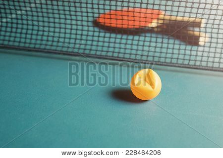 Copy Space And Soft Focus At Broken Ping Pong Ball On The Table Tennis / Soft Light Background With