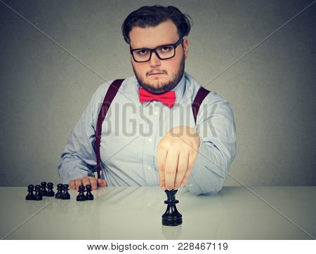 Young Serious Business Man Playing Chess Game