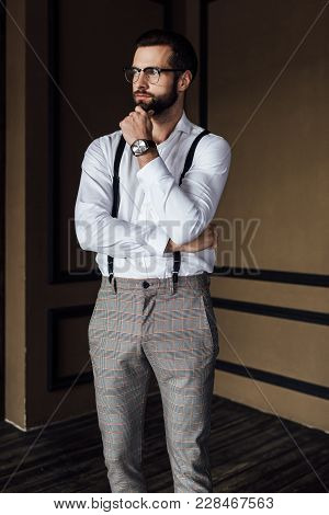 View Of Pensive Fashionable Man In Trendy Suspenders