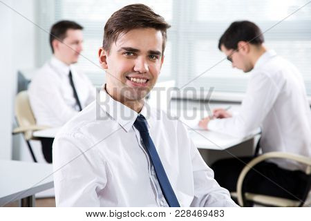 Portrait of young businessman working in an office