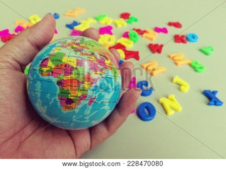 Hand holdings globe ball