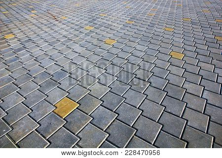 Pattern of modern paving tiles. Diminishing perspective view.