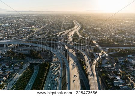 Aerial sunrise view of 105 and 110 freeway interchange ramps in Los Angeles California.