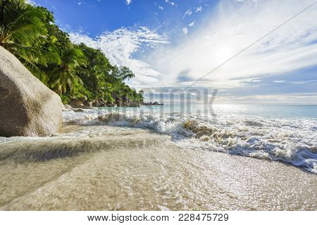 Paradise Tropical Beach With Rocks,palm Trees And Turquoise Water In Sunshine, Seychelles 11