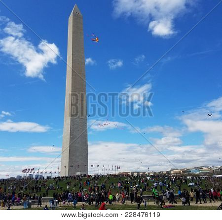 Washington, Dc - April 01, 2017: A Large Crowd Of Adults And Children Flying Kites At The Kite Festi