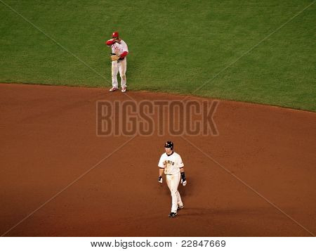 Giants Buster Posey Takes Lead From Second Base With Jimmy Rollins At Shortstop Behind Him