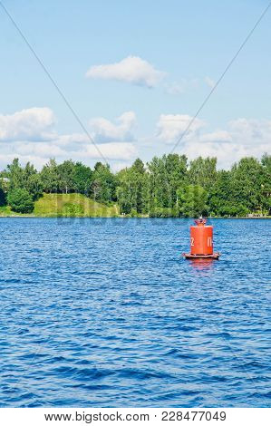 Buoy On A Lake On A Summer Day