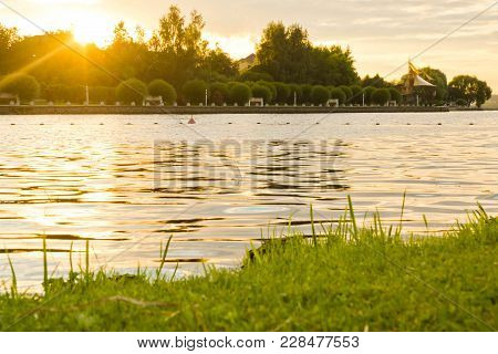 Sun At Sunset Over A Pond On Summer Evening