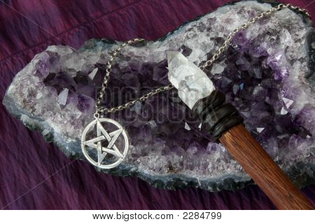 close up of wiccan objects - pentacle pendant crystal wand on amethyst geode poster