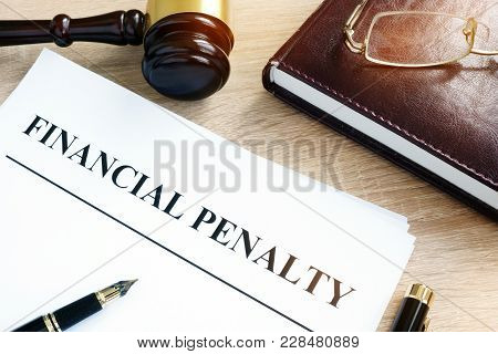 Document with title Financial penalty on a desk. poster