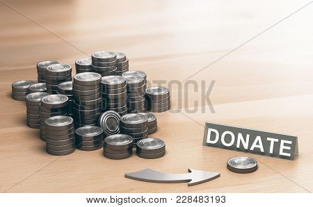 Piles Of Coins Symbols On A Wooden Table And An Arrow Pointing A Single Coin With The Word Donate. D