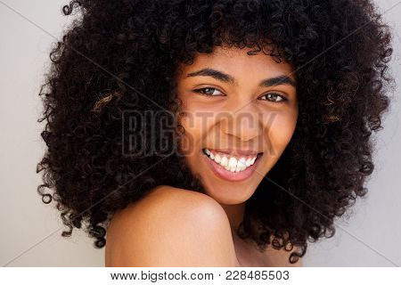 Close Up Cheerful Young African American Woman With Curly Hair