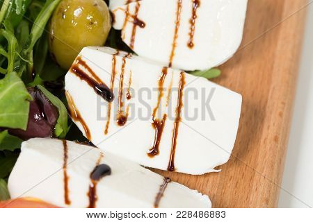 Starter Platter With Mozzarella And Olives. Macro. Photo Can Be Used As A Whole Background.