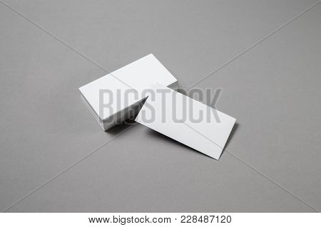Blank White Business Cards On Grey Paper Background. Mockup For Branding Identity. Template For Grap