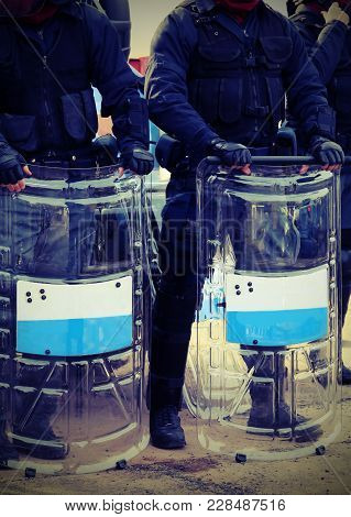 Anti-riot Police Officers With Bullets And Protective Shields With Vintage Effect