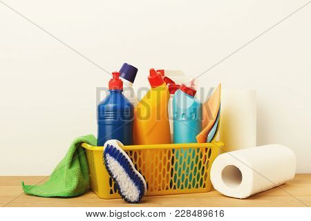 Bucket With Cleaning Items On Wood Table, Close Up. Bucket, Brush, Towels, Disinfection Product And