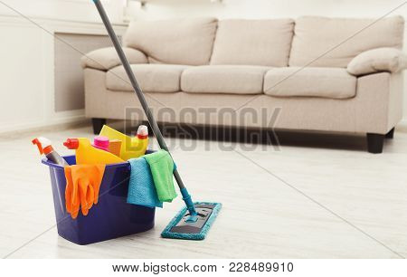 Bucket With Sponges, Chemicals Bottles, Mopping Stick, Rubber Gloves And Towel. Household Equipment