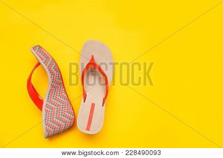 Bright Summer Women's Sandal Isolated On Yellow Background. Top View