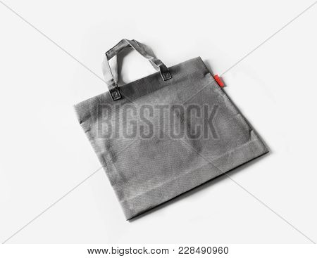 Blank Gray Shopping Canvas Bag On White Paper Background.
