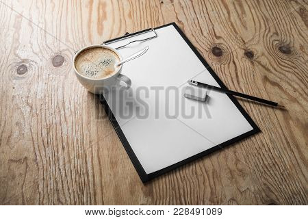 Clipboard With Blank Letterhead, Coffee Cup, Pencil And Sharpener On Wood Table Background. Mock Up