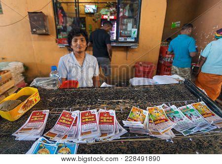 Dambulla, Sri Lanka - Jan 7, 2017: Seller Of Lottery Tickets On The Busy City Market On January 7, 2