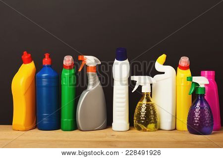 Group Of Colorful Bottles, Cleaning Products On Dark Background. House Keeping, Tidying Up, Spring-c
