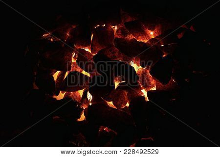 Representation Of Embers And Fire With The Help Of Light And Stones