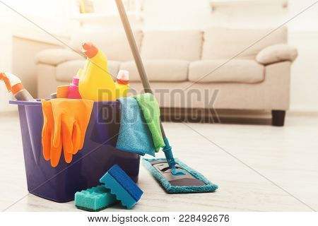 Bucket With Sponges, Chemicals Bottles, Mopping Stick, Rubber Gloves And Towel. Household Equipment,