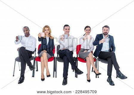 Lunch Time. Attractive Exuberant Stylish Young Co-workers Smiling And Drinking Coffee And Sitting On