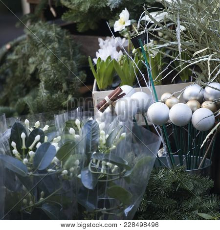 The Spruce Wreaths, Cinnamon And Glass Balls As Decorations Are Sold On The Flower Market By Christm