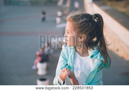 Cute Smiling Little Girl Outoors In Spring