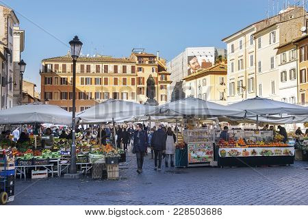 Rome, Italy - January 23: Daily Food Market With The Statue Of Giordano Bruno At Square Campo Dei Fi