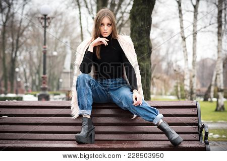 Beautiful Girl In Casual Clothes. On The Street There Is Snow. Gloomy Makeup. Fashionable Woman. Cas