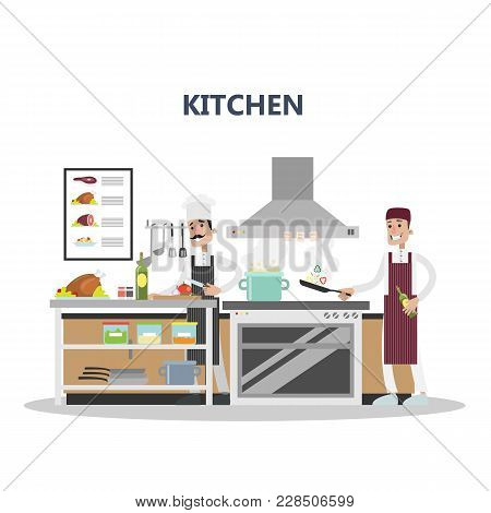 Kitchen In Restaurant With Chef And Equipment.