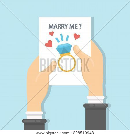 Will You Marry Me Greeting Card In Hands.