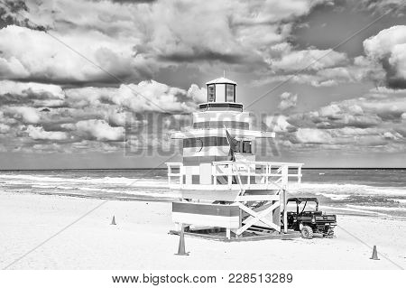 South Beach, Miami, Florida, Lifeguard House In A Colorful Art Deco Style White And Red On Cloudy Bl