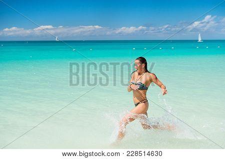 Sexy Woman Run In Sea Water In Antigua. Sexy Woman In Sexy Bikini On Sea Beach On Summer Vacation.