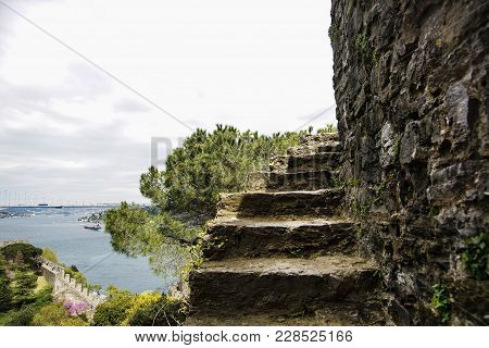 Part Of An Abrupt Ladder Of Fortress Of Rumeli Hisari Aspiring Into Sky. At A Background Bosphorus A