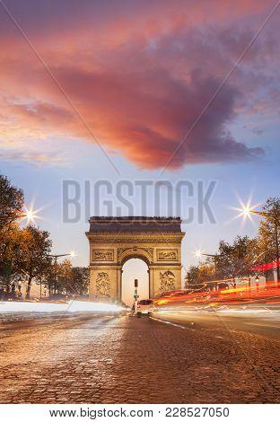 Arc De Triumph At Night In Paris, France