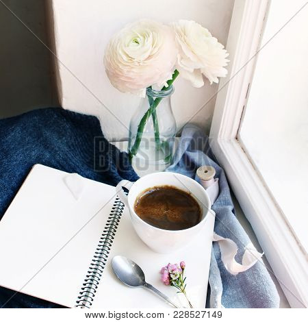 Cozy Spring Still Life. Mug Of Hot Coffee, Opened Empty Notebook With Warm Plaid On Vintage Windowsi