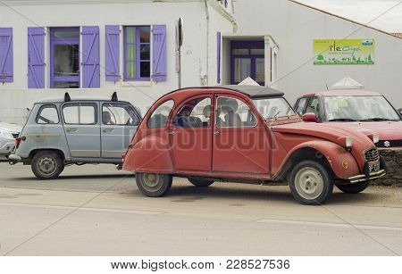 Ile D'yeu, France - May 25, 2016: Old Vintage Cars Citroen On The Street Of City