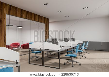 White And Wooden Office Interior With White Tables, Computers On Them And Blue And Red Chairs. 3d Re