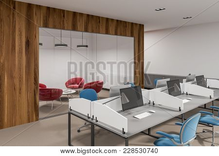 White And Wooden Office Interior With White Tables, Computers On Them And Blue And Red Chairs. A Sid