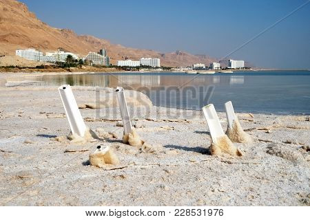 Chairs Covered With Salt In The Dead Sea In Ein Bokek