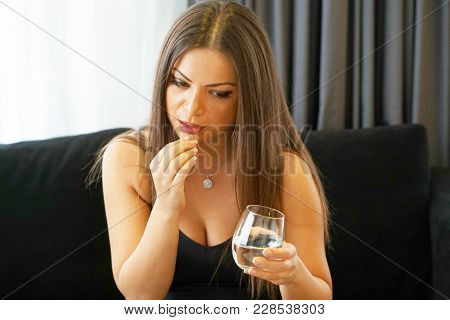 Sick Young Woman Holding Pill Glass Of Water At Work,depressed Unhealthy Woman, About To Take Antide
