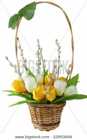 Arrangement Of Artificial Flowers And Pussy Willows In Braided Basket Isolated